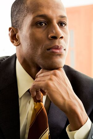 Portrait of thoughtful businessman thinking during work Stock Photo - 3929317