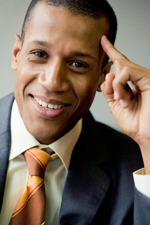 Portrait of cheerful businessman smiling and touching his head Stock Photo - 3929299