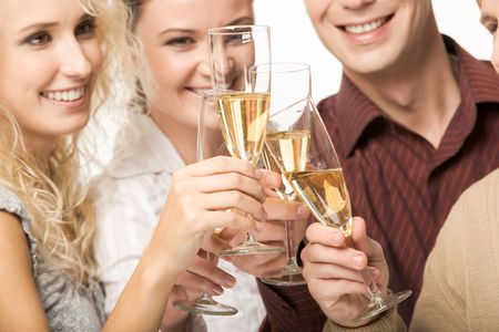 Photo of happy friends holding glasses full of champagne and smiling during party photo