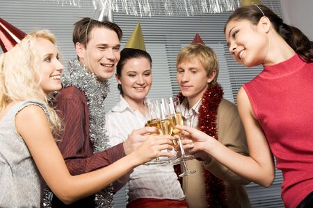 Happy people toasting with glasses of champagne in hands while looking at each other joyfully Stock Photo - 3929327