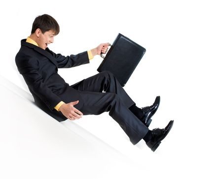 Image of sliding businessman with briefcase in hand over white background Stock Photo - 3929183