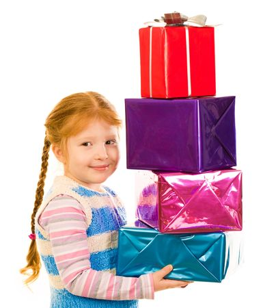 Portrait of happy child holding heap of colorful boxes with gifts photo