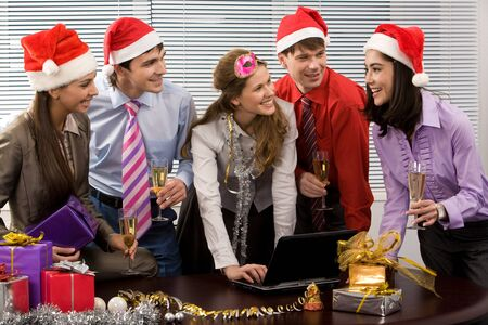Portrait of happy business people chatting while celebrating Christmas in office photo
