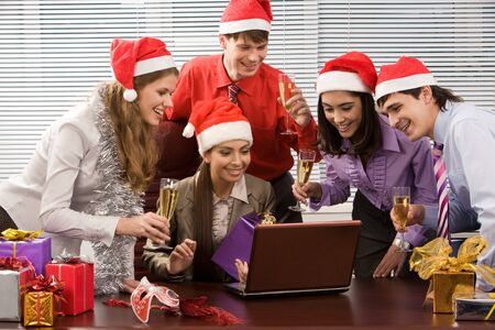 Portrait of excited co-workers gathered together in office and having corporate party photo
