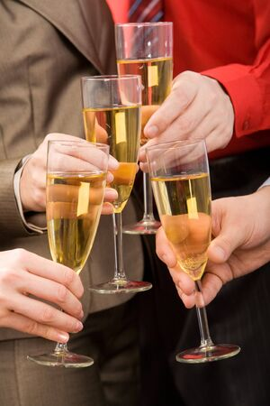 Close-up of human hands cheering up with flutes of golden champagne Stock Photo - 3971081