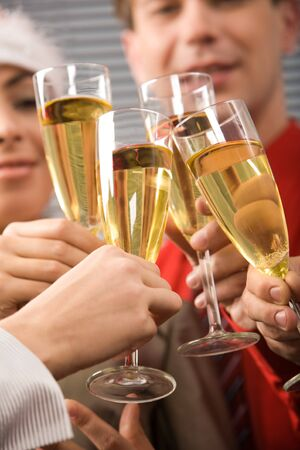 Image of businesspeople hands holding crystal glasses full of champagne Stock Photo - 3968157