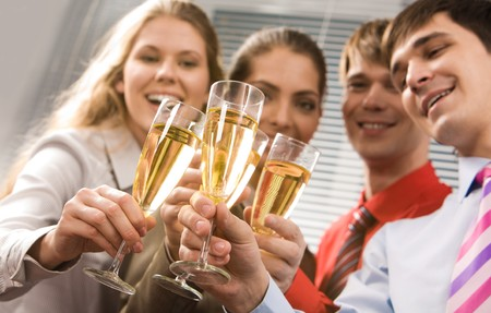 Photo of businesspeople cheering up their flutes filled with sparkling champagne Stock Photo - 3968158
