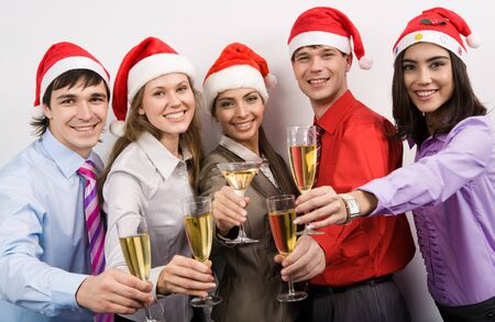 Portrait of smart colleagues with flutes of champagne while toasting photo