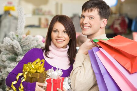 Portrait of joyful husband and wife going shopping before Christmas photo