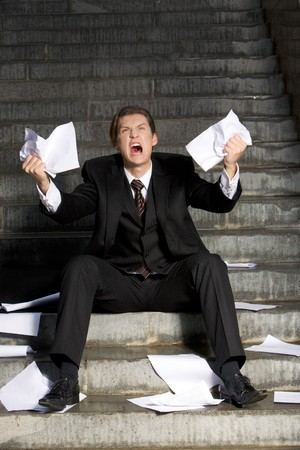 Image of grieving businessman crying with papers in hands Stock Photo - 3968202