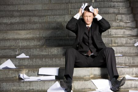 Image of frustrated professional with his eyes closed in grief during crisis Stock Photo - 3968203