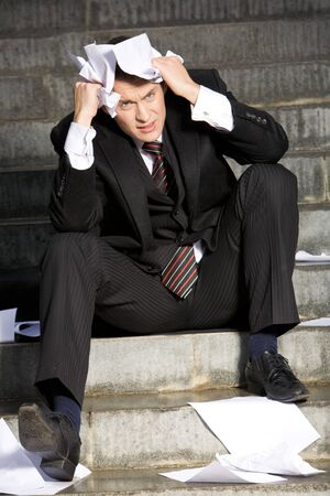 Portrait of unhappy businessman under depression touching his head in grief Stock Photo - 3968188