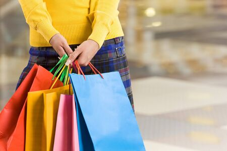 personal shopper: Close-up of colorful paperbags being held by female in the shopping center Stock Photo