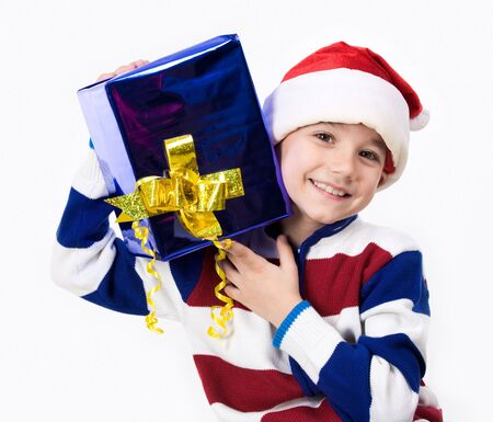 Portrait of happy lad with nice gift in hands looking at camera and smiling photo