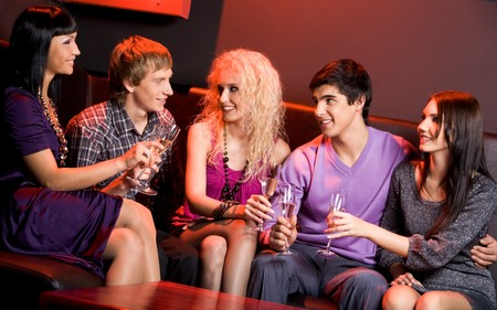 Portrait of smart friends with flutes in hands communicating at party Stock Photo - 3997617