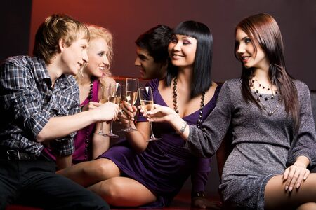 Portrait of joyful friends toasting with flutes of champagne at party Stock Photo - 3997622
