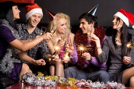 Company of attractive people having fun on Christmas night Stock Photo - 3997635
