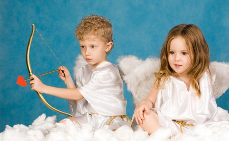 Portrait of two young angels sitting on the cloud  photo