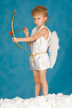 seraphic: Portrait of young male angel holding bow  Stock Photo