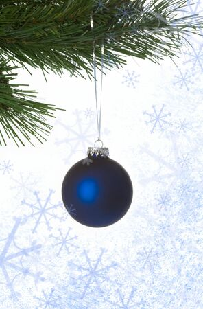 Image of blue decorative toy ball hanging on spruce branch surrounded by snowflakes Stock Photo - 4058700