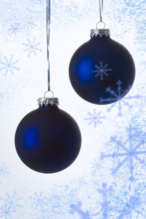 flurry: Close-up of blue decorative Christmas balls over flurry background