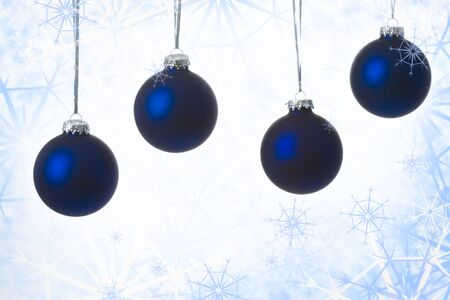 flurry: Image of four blue decorative toy balls over winter background Stock Photo