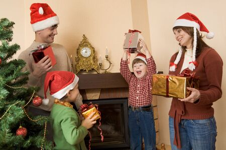 Portrait of happy family celebrating cristmas at home  Stock Photo - 4113759