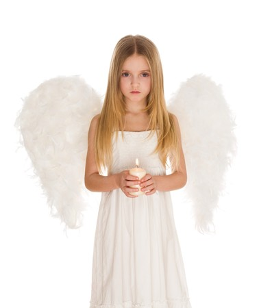 Portrait of girl in angelic costume holding candle