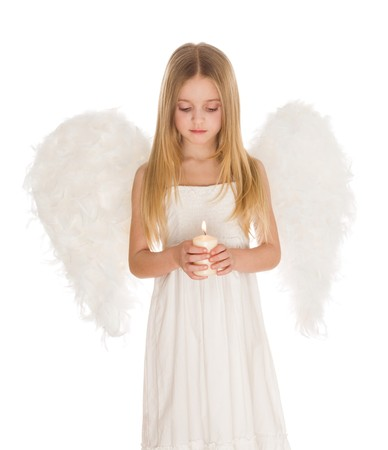 praying angel: Portrait of white angel holding burning candle and looking at it over light background Stock Photo