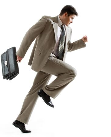 running businessman: Image of serious businessman hurrying to his work Stock Photo