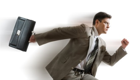 Portrait of energetic businessman carrying briefcase and running