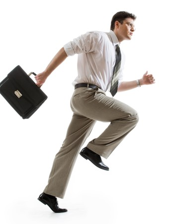 Busy businessman with briefcase running to important meeting photo