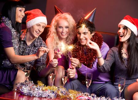 company party: Photo of cheerful friends laughing and having fun at Christmas party