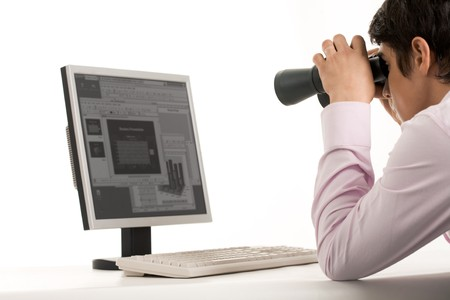 Photo of white collar worker with binoculars looking at monitor of computer  photo