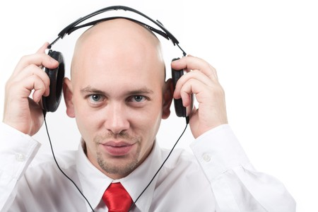 Portrait of handsome male preparing for listening to music through headphones photo