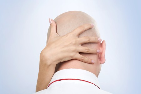fondling: Image of female�s hand on back of male�s bald head