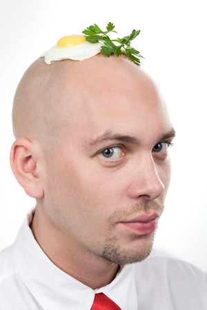 amazement: Portrait of strange man with fried egg on top of bald head