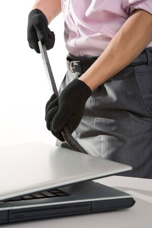 Photo of man in black gloves breaking the laptop  Stock Photo - 4193026