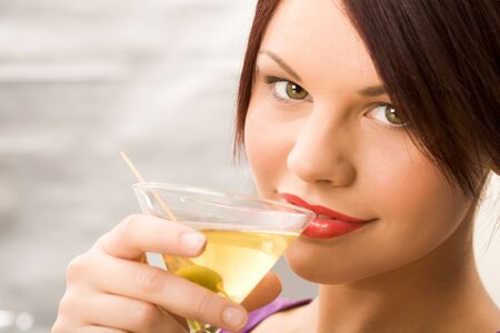 Image of young smiling girl holding cocktail photo
