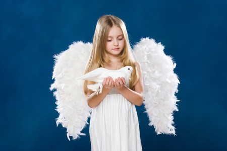 Portrait of light angel with purely white dove looking at it with love photo