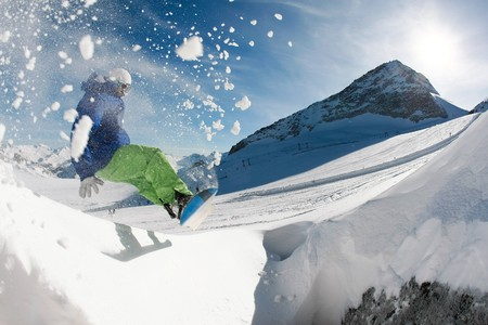 Photo of snowboarder over snowdrift going in for sport in winter photo