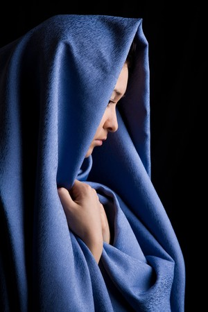 harem: Portrait of pensive religious woman on a black background  Stock Photo