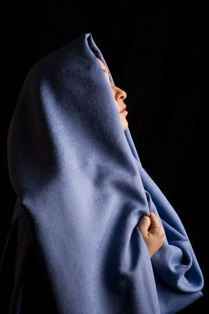 yashmak: Image of moslem woman with blue fabric on her head