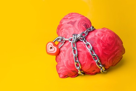 Creative image of soft toy heart bound with chain and small padlock Stock Photo - 4258087
