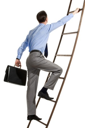 corporate ladder: Portrait of businessman with briefcase climbing on staircase