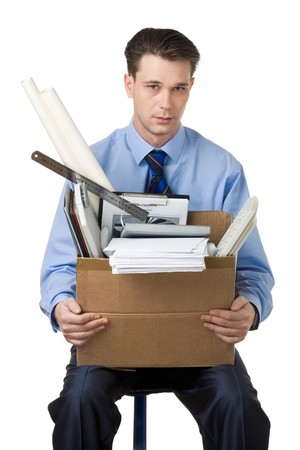 white collar worker: Portrait of businessman holding box with documents sitting on the chair