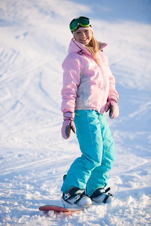 Image of happy girl on winter resort snowboarding there photo