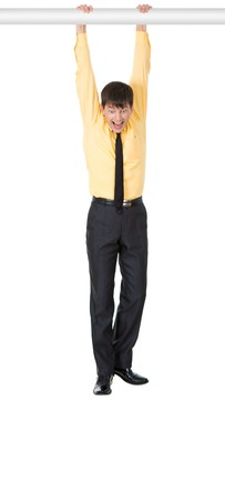 Photo of scared businessman hanging while holding by horizontal bar over white background Stock Photo - 4252441