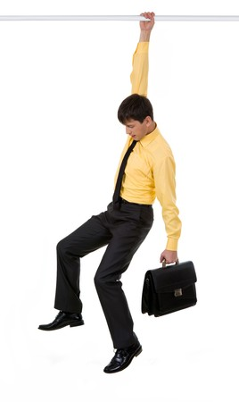 hanging: Creative image of frustrated businessman holding by horizontal bar with briefcase in another hand