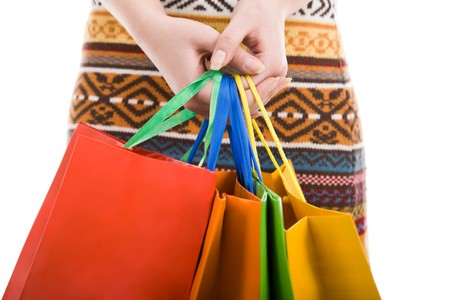 Close-up of female hands with colorful shopping bags Stock Photo - 4258079